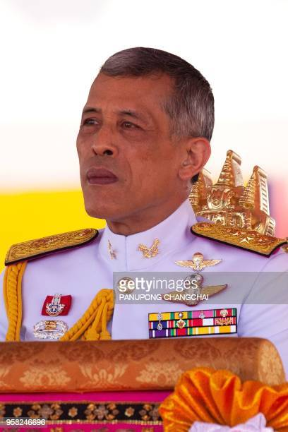 Thai King Maha Vajiralongkorn presides over the annual royal ploughing ceremony outside Bangkok's royal palace on May 14 2018 Thai palace astrologers...