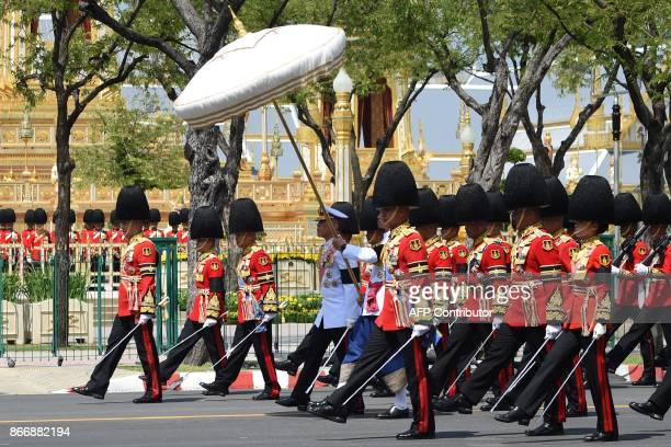 Thai King Maha Vajiralongkorn takes part in a funeral procession where the relics and ashes of his father the late Thai king Bhumibol Adulyadej will...