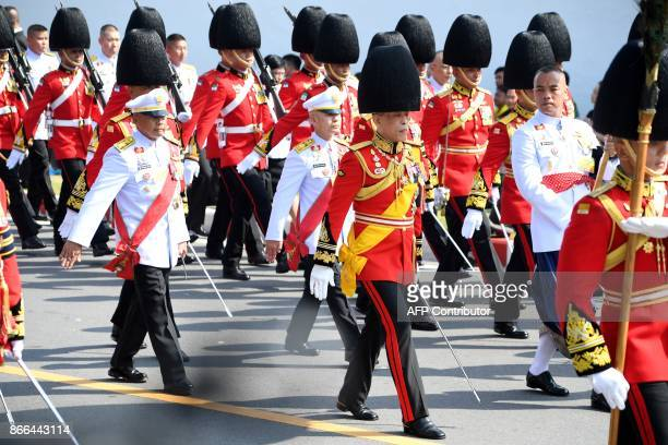 Thai King Maha Vajiralongkorn takes part in the funeral procession for his father the late Thai king Bhumibol Adulyadej in Bangkok on October 26 2017...