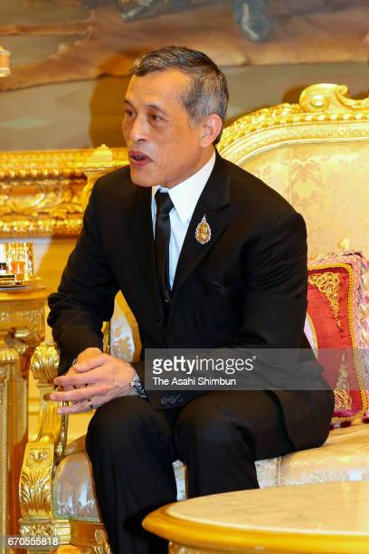 Thai King Maha Vajiralongkorn talks with Emperor Akihito and Empress Michiko after paying respects to the late King Bhumibol Adulyadej at the Grand...