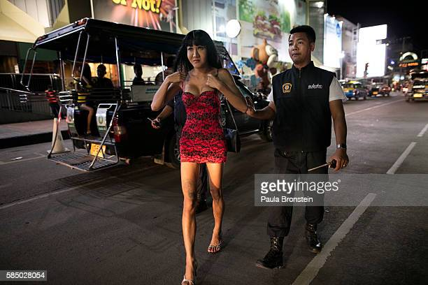 Thai ladyboy is taken to a police truck after being arrested July 30 2016 in Pattaya Thailand Thailand's first female minister of tourism would like...