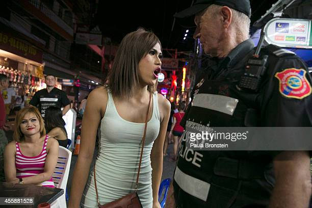Thai ladyboy voices her disapproval for being detained while waiting to be taken to the police station September 21 2014 in Pattaya Thailand Pattaya...