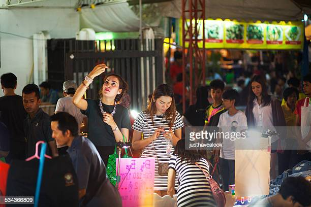 thai ladyboys at cosmetics market stall - ladyboys of bangkok stock photos and pictures