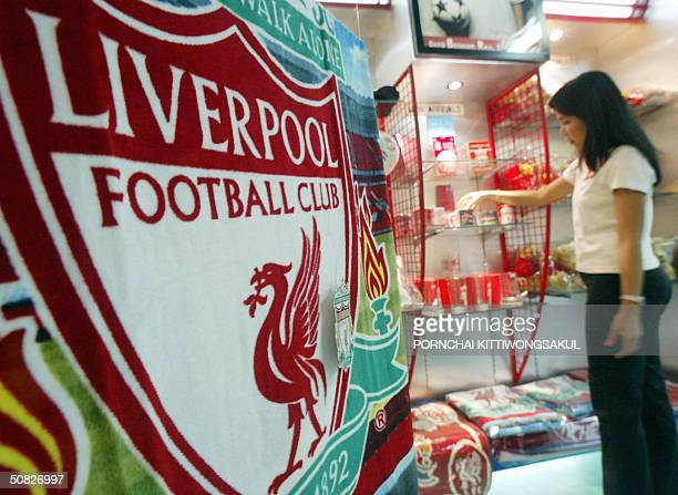 Thai Liverpool fan chooses souvenir cups at the football souvenir shop in Bangkok 12 May 2004 Thailand's media was dominated Wednesday by anger and...