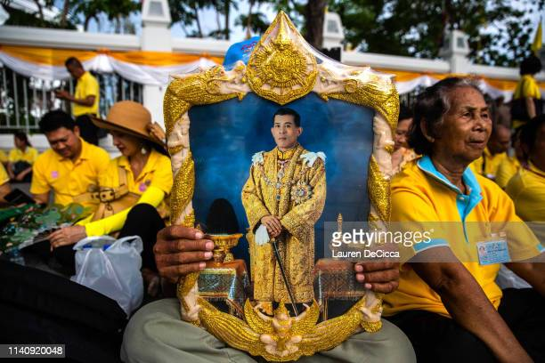 Thai man holds a portrait of King Maha Vajiralongkorn ahead of the Royal Coronation on May 3 2019 in Bangkok Thailand