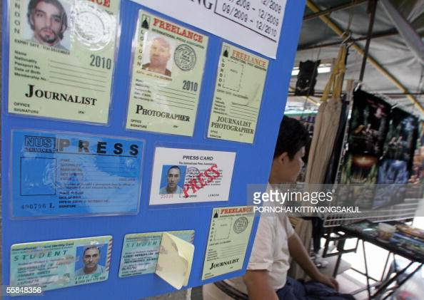 Images San Next Sits Card Man Road A Khao To Photo Thai Stall - News Getty Fake Identity At