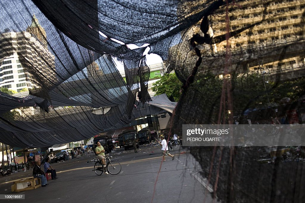 A Thai man stands stands in the place where the Red Shirt protesters main stage stood in the financial centre of Bangkok on May 20, 2010. Thai troops hunted for militant protesters who left parts of Bangkok in flames as the authorities extended a night curfew in the capital despite tentative signs of a return to normality