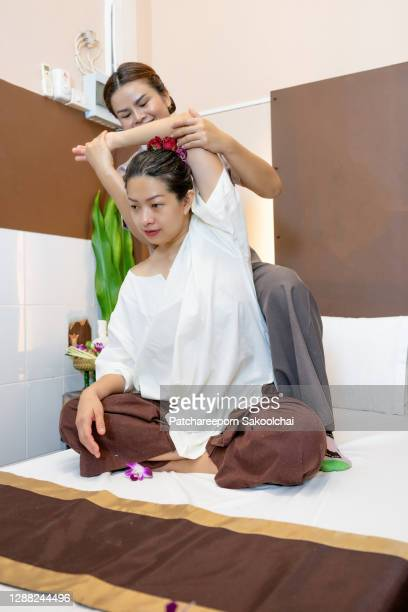 thai massage - thai ethnicity stock pictures, royalty-free photos & images