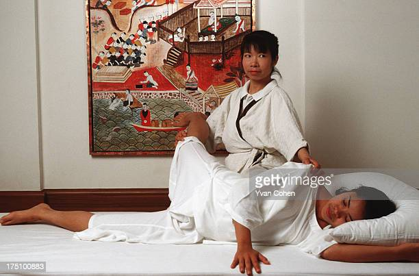 Thai masseuse at the Regent Hotel in Chiang Mai demonstrates traditional massage techniques Massage is an ancient practice in Thailand and is...