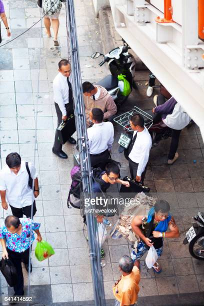 thai men and students on sidewalk - gehweg stock pictures, royalty-free photos & images