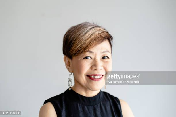thai middle-aged businesswoman - thai ethnicity stock pictures, royalty-free photos & images