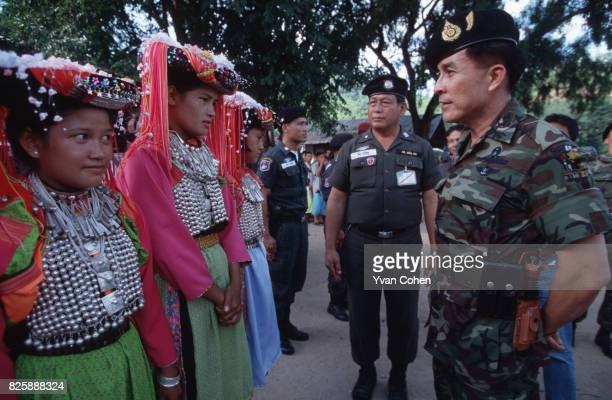 Thai military dignitary LtGen Pathompong Kesornsuk tries to open some conversation with a welcoming delegation of lisu girls in the village of Ban...