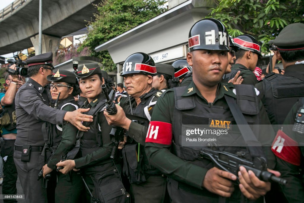 Thai military police take cover as tensions rise during anti-coup protests on May 28, 2014 in Bangkok, Thailand. Widespread Facebook outage occurred in Thailand on Wednesday afternoon while the ruling military junta who staged a coup last week denied that they caused it. The Thai military has warned Thai citizens about expressing dissent using social media. Thailand is known as a country with a very unstable political record and is now experiencing it's 12th coup with 7 attempted pervious coups.