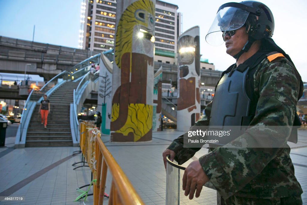 BANGKOK, THAILAND - MAY 29; Thai military stand guard in the center of the shopping district trying to stop the anti-coup protesters May 29, 2014 in Bangkok, Thailand. Thai military rulers have warned Thai citizens about expressing dissent using social media. Thailand is known as a country with a very unstable political record and is now experiencing it's 12th coup with 7 attempted pervious coups.