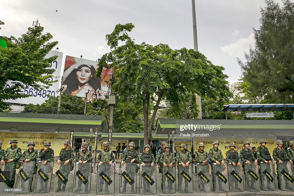 Thai military stand guard on the quiet streets surrounding the Victory Monument that were blocked from all traffic in order to stop the anti-coup protesters on May 29, 2014 in Bangkok, Thailand. Thai military rulers have warned Thai citizens about expressing dissent using social media. Thailand is known as a country with a very unstable political record and is now experiencing it's 12th coup with 7 attempted pervious coups.