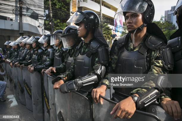 Thai military wear riot shields as tensions increase during an anticoup protest on the second day of Thailand's military coup May 24 2014 in Bangkok...