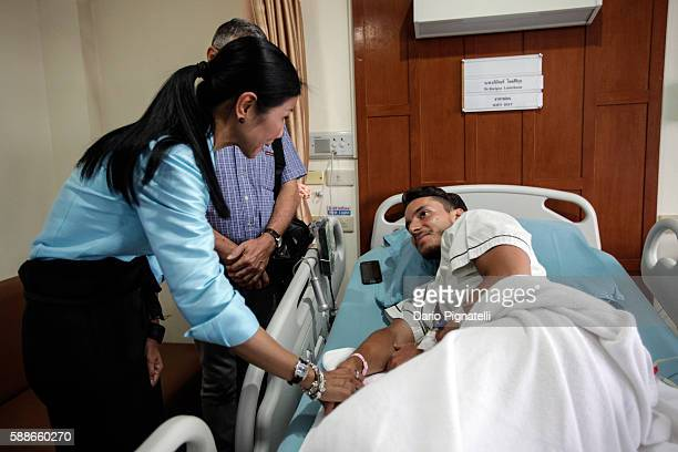 Thai Minister for Tourism and Sports Kobkarn Wattanavrangkul meets Italian tourist Lorenzo Minuti who got injured during one of the bomb attacks at...
