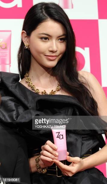 Thai model Davika Hoorne poses with Shiseido's skincare cream Za at a press preview in Tokyo on September 13 2012 Shiseido's popular skincare and...