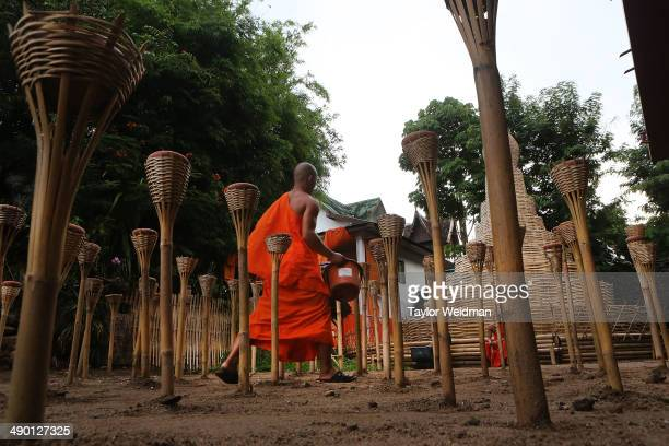 Thai monks at Wat Pan Tao prepare for evening ceremonies to celebrate Visak Day on May 13 2014 in Chiang Mai Thailand Visak Day is a Theravada...