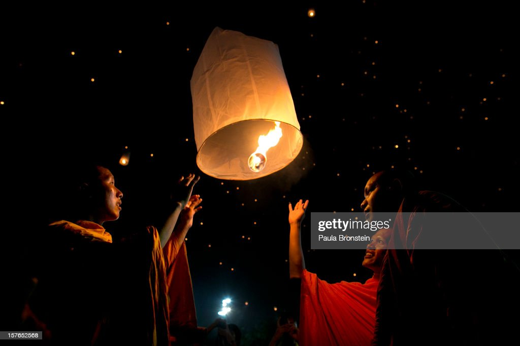 Thai monks light a lantern and release it to the night sky during celebrations to pay respect to Thailand's King Bhumibol Adulyadej on his 85th birthday December 5, 2012 in Bangkok, Thailand. King Bhumibol took the throne in 1946, making him the world's longest reigning monarch and the world's longest serving head of state. Yellow represents Monday, the birthday of the King.