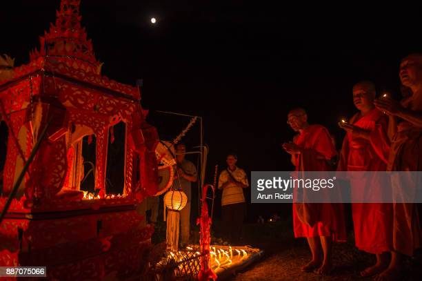 Thai monks pray as they light floating lanterns to celebrate the Jong Phara and Loy Krathong Festival at Wat Muay Tor in Khun Yuam, Mae Hong Son, Thailand.