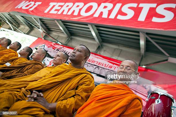 Thai monks pray during a special prayer ceremony for people who died on April 10 during clash between Anti-government protesters 'Red Shirt' and Thai...