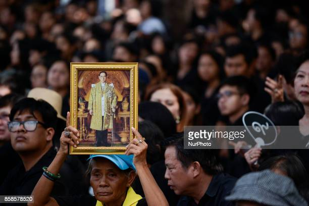 Thai mourner holds a portrait of the late Thai King Bhumibol Adulyadej during a funeral rehearsal for late Thailand's King Bhumibol Adulyadej near...
