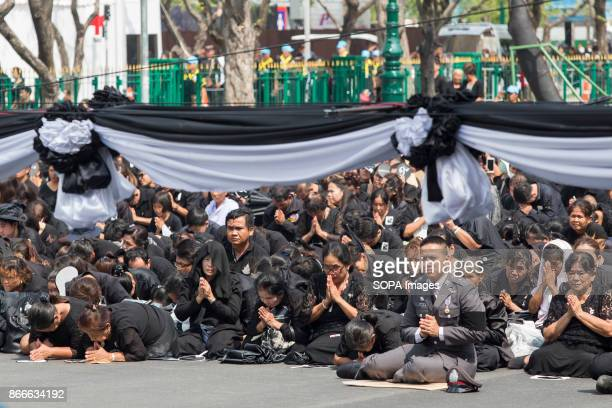Thai mourners participate at the ceremony for moving the funeral urn of King Bhumibol Adulyadej is moved from the Grand Palace to the Royal...