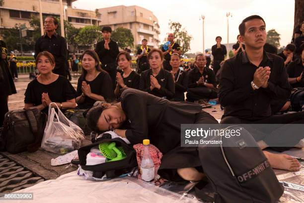 Thai mourners pray during a religious ceremony on the day of the historical cremation of Thailand's King Bhumibol on October 26 Bangkok Thailand The...