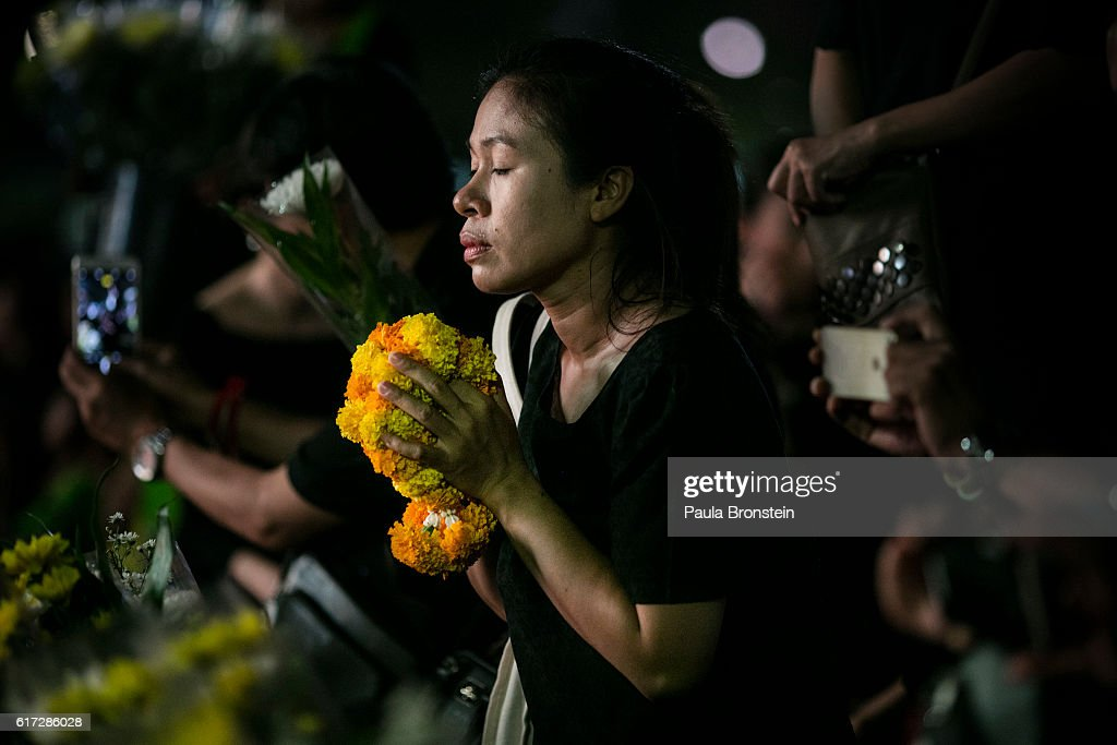 Thai mourners say prayers next to a portrait of the late King on October 22, 2016 in Bangkok, Thailand. Tens of thousands attended the emotional event singing the Royal anthem which was filmed as a tribute to Thailand's King Bhumibol Adulyadej, the world's longest-reigning monarch, died at the age of 88 after his 70-year reign. The Crown Prince Maha Vajiralongkorn had asked for time to grieve the loss of his father before becoming the next king as nation waits for the coronation date.