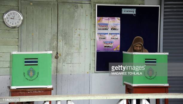 A Thai Muslim woman casts her vote at a polling station in Thailand's restive southern province of Narathiwat on July 3 2011 Thailand voted on July 3...