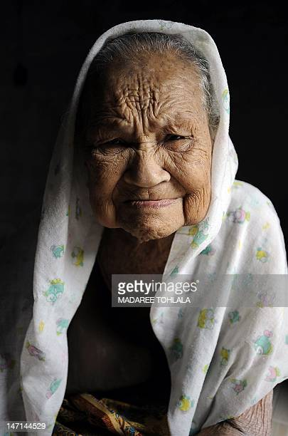 Thai Muslim woman Tuweasong Tuweanok 103yearold poses for pictures at her home in Thailand' southern province of Narathiwat on April 10 2012 AFP...