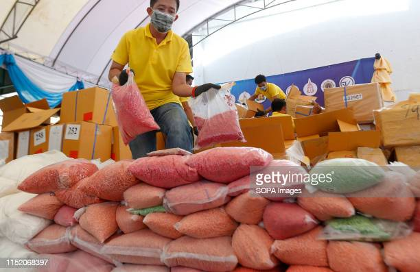 Thai narcotics official arranges bags of methamphetamine pills during the 49th Destruction of Confiscated Narcotics ceremony to mark the...