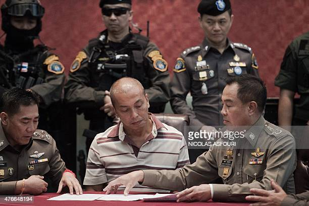 Thai national police chief Somyot Poompanmoung sits next to Montri Sotangkul who was a member of the household staff of Princess Srirasmi Crown...