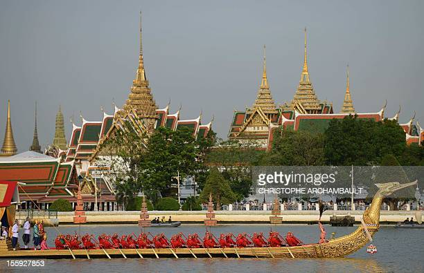 Thai Navy oarsmen row a barge in front of the Royal Palace during the Royal barge procession held on the Chao Phraya River in Bangkok on November 9...