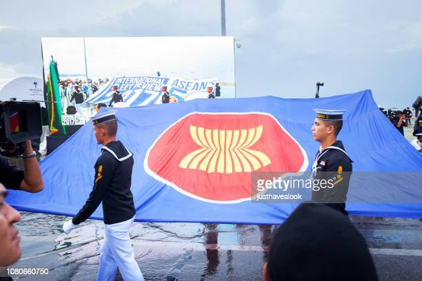 thai navy soldiers with huge asean flag - association of southeast asian nations stock pictures, royalty-free photos & images