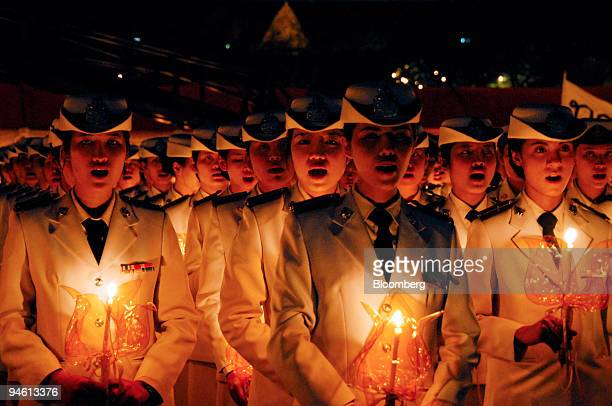 Thai officer cadets sing Long live the King during a candle lighting ceremony to honor the King of Thailand the world's longest reigning monarch...