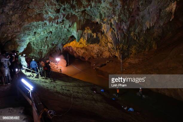 Thai officers supervise the rescue mission inside Tham Luang Nang Non cave on June 28 2018 in Chiang Rai Thailand Rescuers battle heavy rain in...