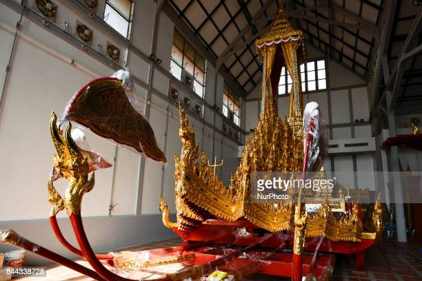 A Thai official works on a royal chariot which will be used to carry the body and the royal urn of late Thai King Bhumibol Adulyadej in the royal...
