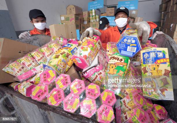 Thai officials fill snacks and food products tainted with the toxic chemical melamine in a container prior to destruction in Ayutthaya the capital...