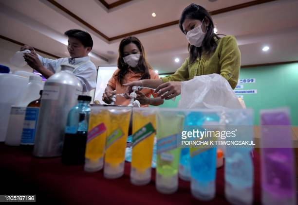 Thai officials give instruction to local people on how to make hygienic hand sanitising gels from alcohol and chemicals for their families at a...