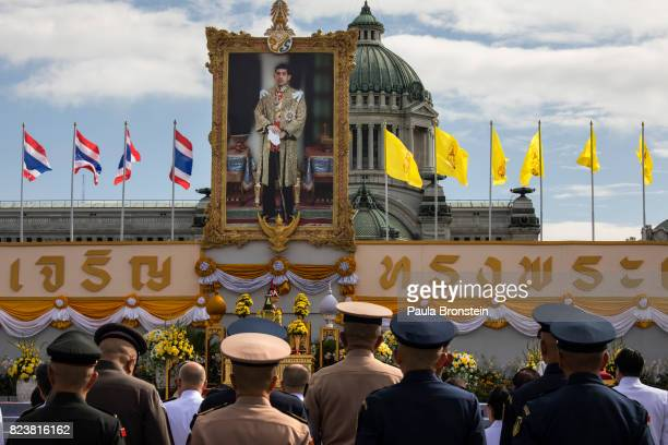 Thai palace officials and military stand at attention at the Royal palace gathering for Meritmaking ceremonies as Thai people celebrate the 65th...