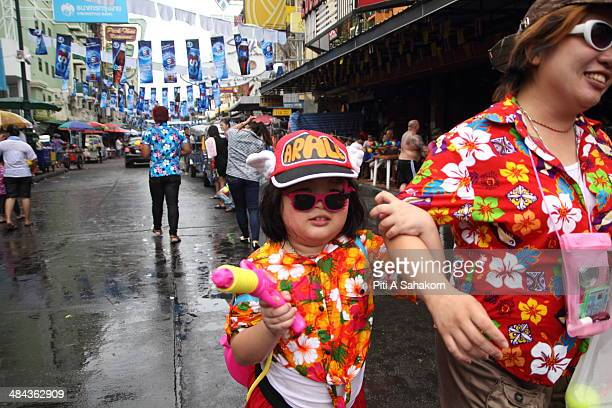 Thai people and foreign tourists take part in water battles to celebrate the Songkran Festival for the Thai New Year at Khao San road in Bangkok The...