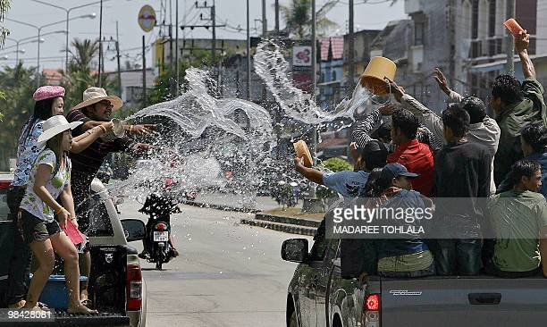 Thai people celebrate the Songkran festival marking the Thai new year in Thailand's southern province of Narathiwat on April 13 2010 Songkran marks...
