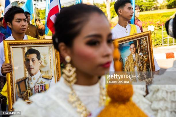 Thai people hold portraits of King Rama X and his father the late King Rama IV in a Labor Day parade on May 1 2019 in Bangkok Thailand The Thai...