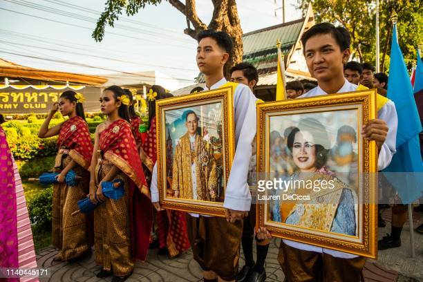 Thai people hold portraits of the late King Rama IV and Queen Sirikit in a Labor Day parade on May 1, 2019 in Bangkok, Thailand. The Thai Ministry of...