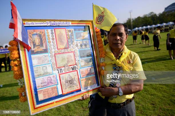 Thai people holds a portrait of King Bhumibol Adulyadej as part of in memory of late Thai King Bhumibol Adulyadej on his birthday anniversary at...