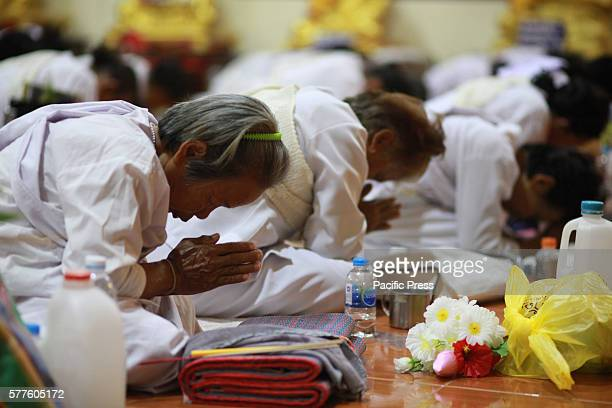 Thai people offer prayers during Asalha Puja Day celebration Thai culture or Asalha Puja Day celebrates the first teaching of Buddha Asalha is also...