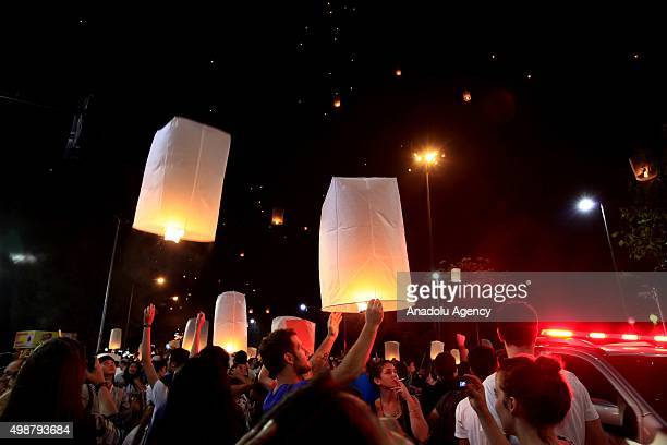 Thai people release the Khom Loi during the opening ceremony of Yi peng festival at the Ta Pae street in Chiengmai Thailand on November 25 2015