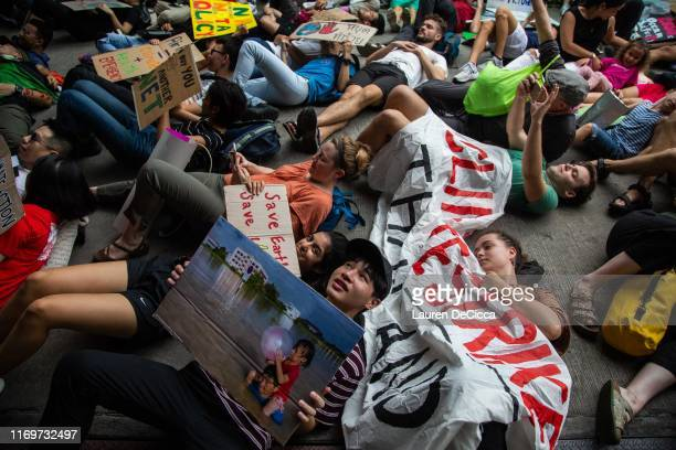 Thai people take part in a diein where strikers lie on the ground and pretend to die symbolising the impact of climate change in front of the...